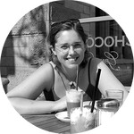 picture of Elizabeth at an outdoor cafe table