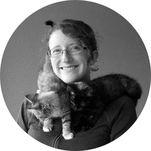 profile picture of Marie and two kittens around her neck